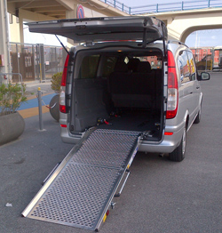 <b>Minivan with ramp for wheelchair confined people</b>